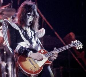 https://www.guitarlessons-atlanta.com/wp-content/uploads/2015/07/Ace_Frehley-300x269.jpg