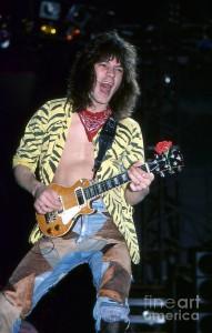 https://www.guitarlessons-atlanta.com/wp-content/uploads/2015/07/eddie-van-halen-little-guitar-david-plastik-191x300.jpg