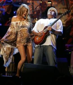 http://www.guitarlessons-atlanta.com/wp-content/uploads/2015/07/fergie-black-eyed-peas-carlos-santana-259x300.jpg